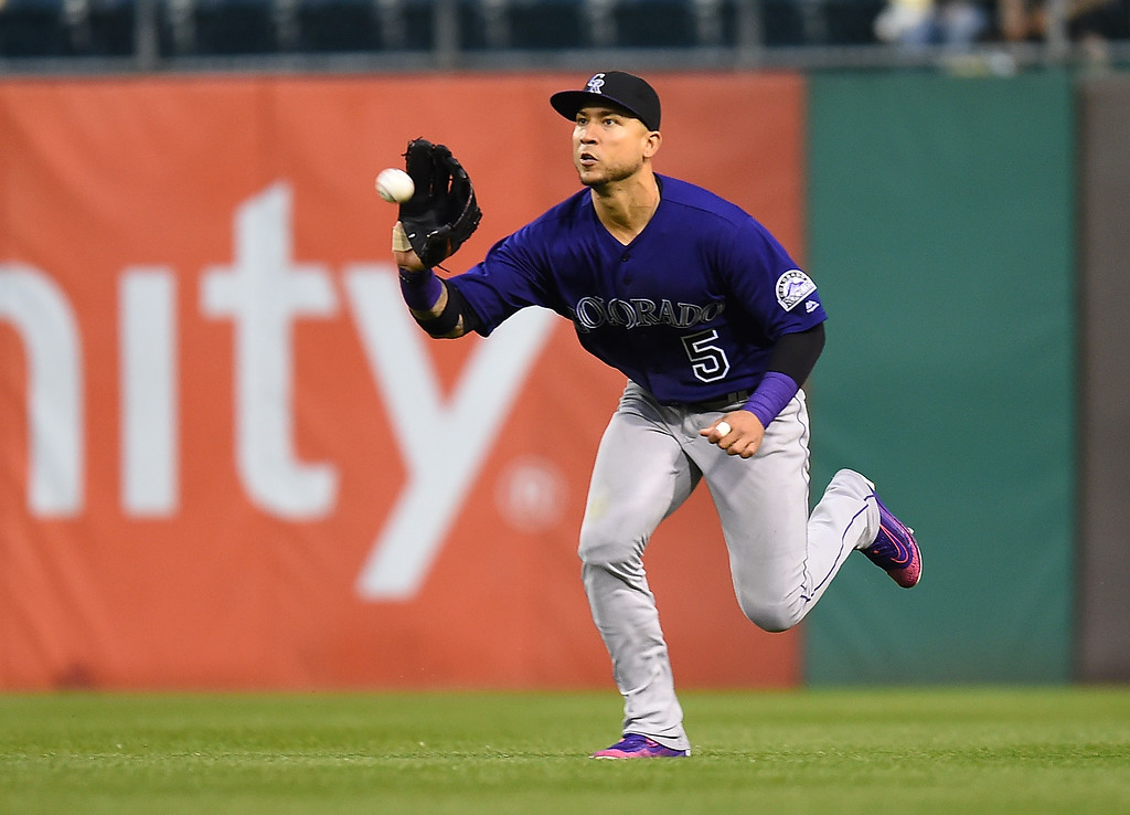 . PITTSBURGH, PA - MAY 21:  Carlos Gonzalez #5 of the Colorado Rockies makes a catch on a ball hit by Jordy Mercer #10 of the Pittsburgh Pirates (not pictured) during the ninth inning on May 21, 2016 at PNC Park in Pittsburgh, Pennsylvania.  (Photo by Joe Sargent/Getty Images)