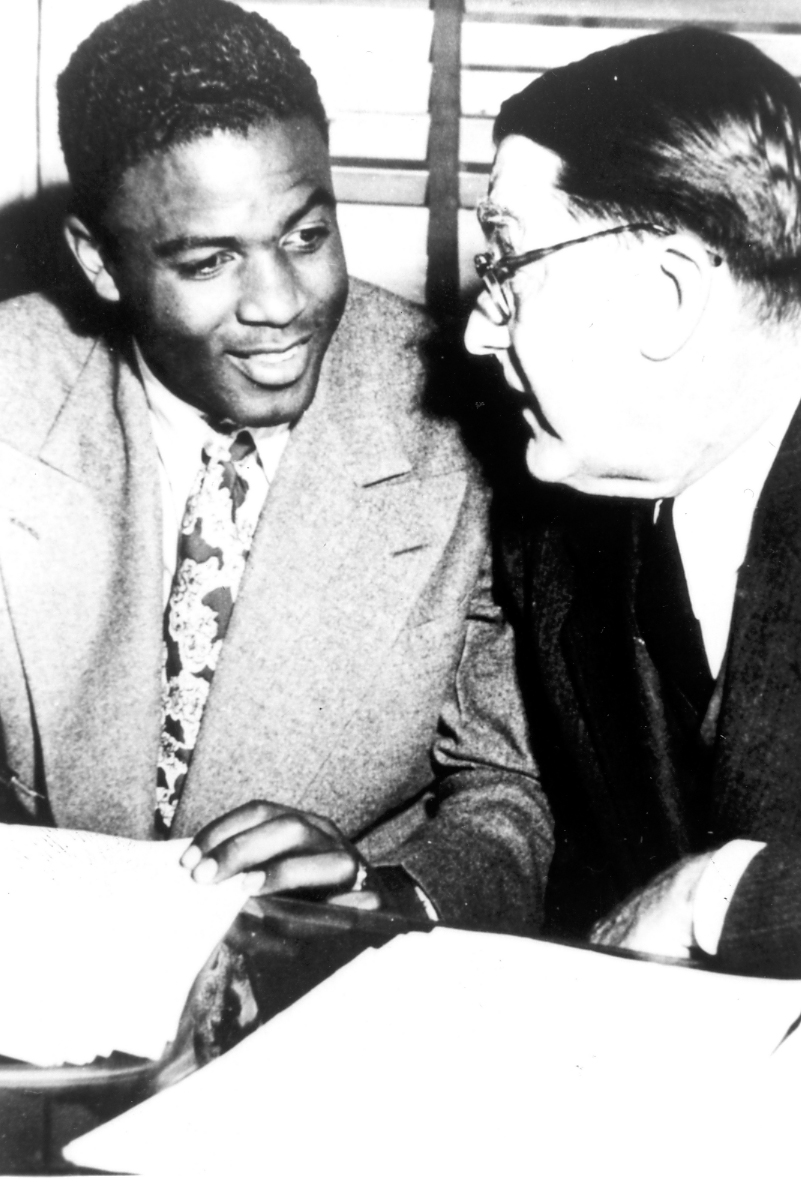 Description of . Jackie Robinson and Branch Rickey as Robinson signed professional contract with Dodger organization in 1946.  Daily News file photo
