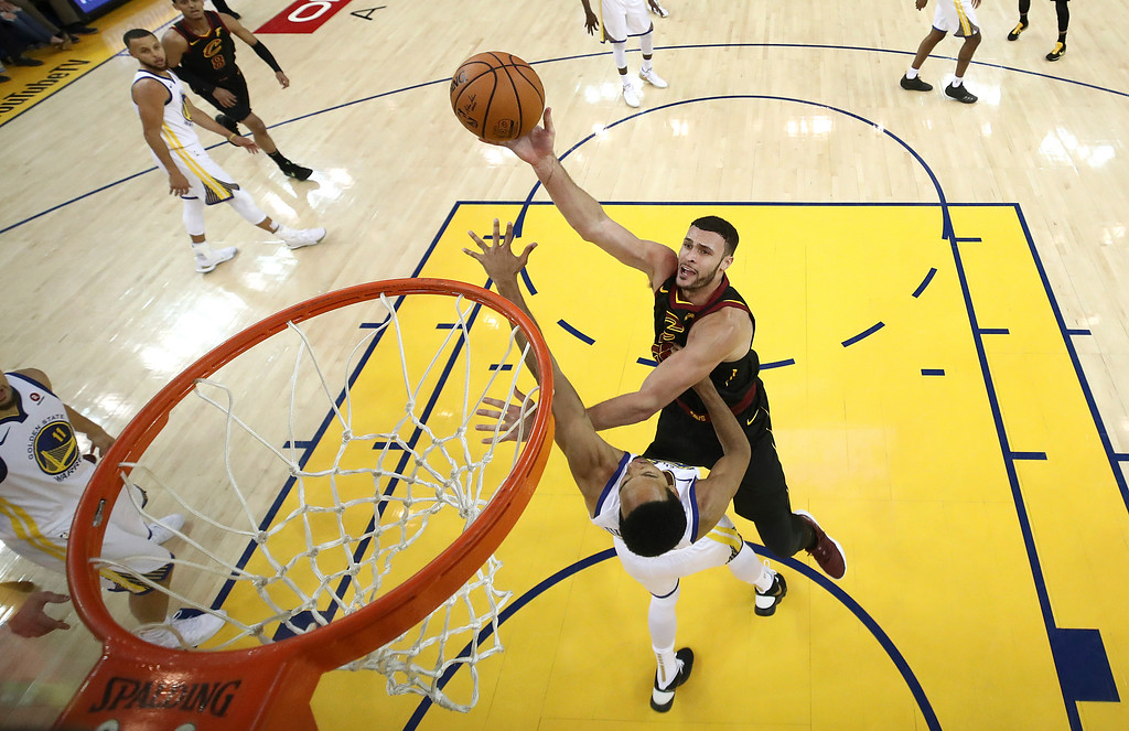 . Cleveland Cavaliers forward Larry Nance Jr., top, shoots over Golden State Warriors guard Shaun Livingston during the second half of Game 1 of basketball\'s NBA Finals in Oakland, Calif., Thursday, May 31, 2018. (Ezra Shaw/Pool Photo via AP)