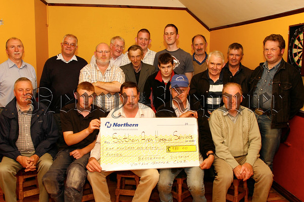 Members of the Bessbrook & District Vintage Tractor Club present a Cheque for £980.00 for the Southern Area Hospice to Michael Crilly (fundraiser), The money was raised at the clubs Lakesides road run, 07W31N54