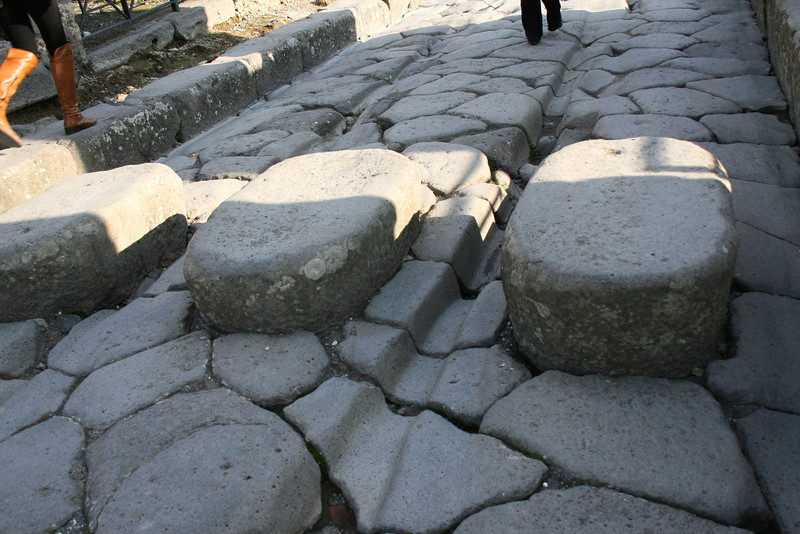 Look at the ruts made in the stone by chariot wheels.  Amazing.  Ancient ruins of Pompeii, Italy