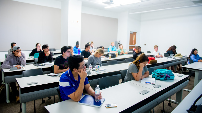 Students listen to the Cost Accounting lecture inside class of professor Elias Sissamis