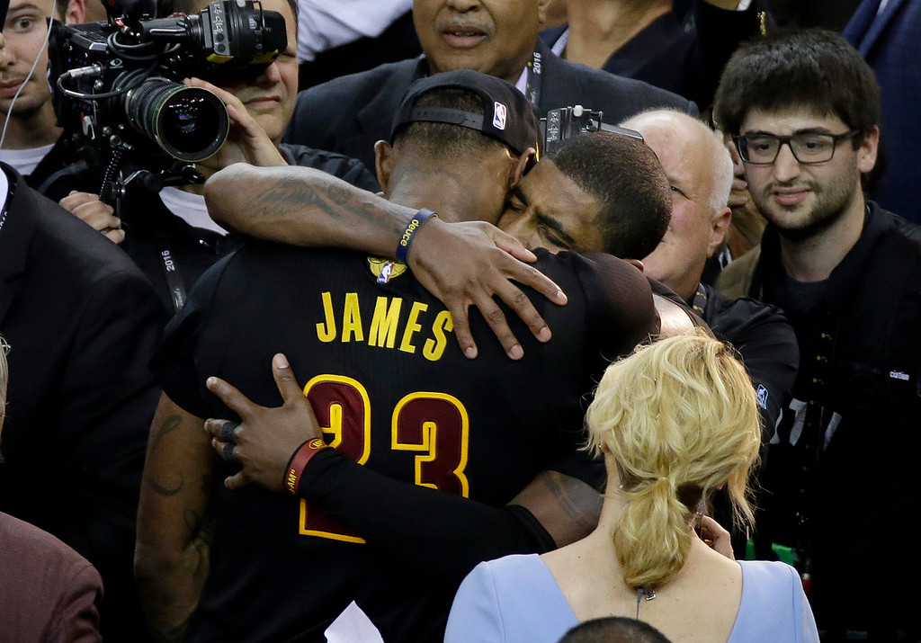. FILE - In this June 19, 2016, file photo, Cleveland Cavaliers forward LeBron James (23) hugs Kyrie Irving after Game 7 of basketball\'s NBA Finals against the Golden State Warriors in Oakland, Calif. After suffering a devastating knee injury for Cleveland during the NBA Finals in 2015, Irving was forced to deal with grueling hours of rehab, where he essentially had to learn to walk again. One year later, he�s got a chance to pull off a rare double win, an NBA championship and Olympic gold medal in less than three months. (AP Photo/Eric Risberg, File)