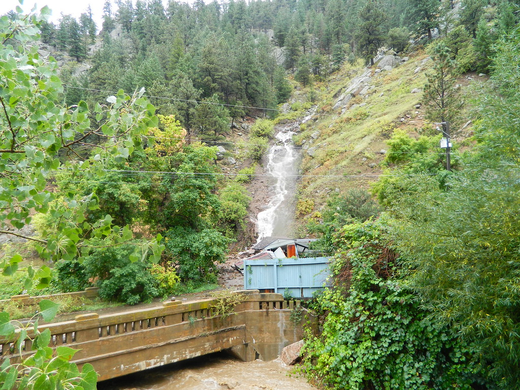 . A culvert washes a shed away in Boulder Canyon. Photo by Jae Beaubier