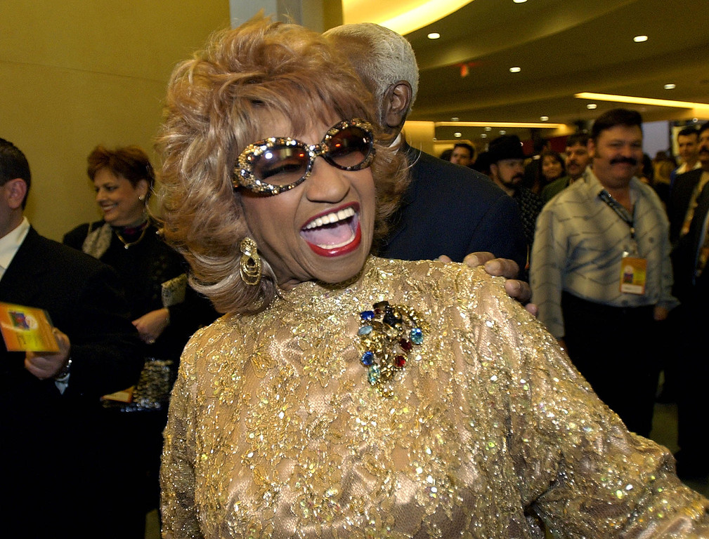 . Cuba\'s Celia Cruz, a Latin Grammy nominee, arrives for a tribute in honor of Mexico\'s Vicente Fernandez as the 2002 Latin Recording Academy person of the year in the Hollywood section of Los Angeles, Tuesday, Sept. 17, 2002.  (AP Photo/Kevork Djansezian)