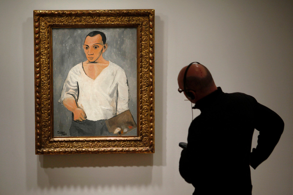 . A person views Pablo Picasso\'s Self-Portrait with Palette, 1906, oil on canvas during the Picasso and the Avant-Garde in Paris exhibit at the Philadelphia Museum of Art in Philadelphia, Wednesday, Feb. 24, 2010.  (AP Photo/Matt Rourke)