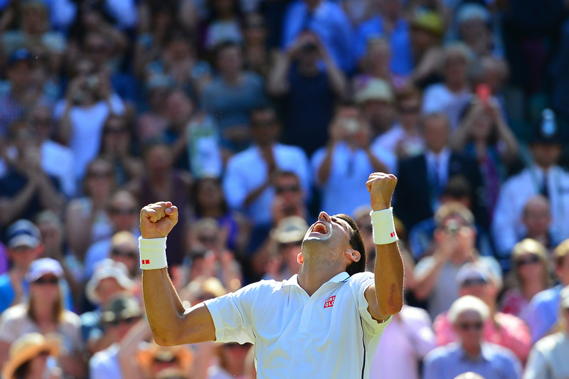 . Serbia\'s Novak Djokovic celebrates winning his men\'s singles semi-final match against Bulgaria\'s Grigor Dimitrov during their on day 11 of  the 2014 Wimbledon Championships at The All England Tennis Club in Wimbledon, southwest London, on July 4, 2014. Djokovic won 6-4, 3-6, 7-6, 7-6. (CARL COURT/AFP/Getty Images)