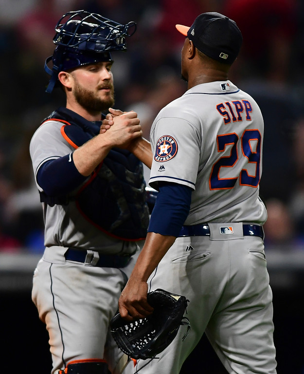. Houston Astros relief pitcher Tony Sipp, right, is congratulated by Max Stassi after the Astros defeated the Cleveland Indians 11-2 in a baseball game Friday, May 25, 2018, in Cleveland. (AP Photo/David Dermer)