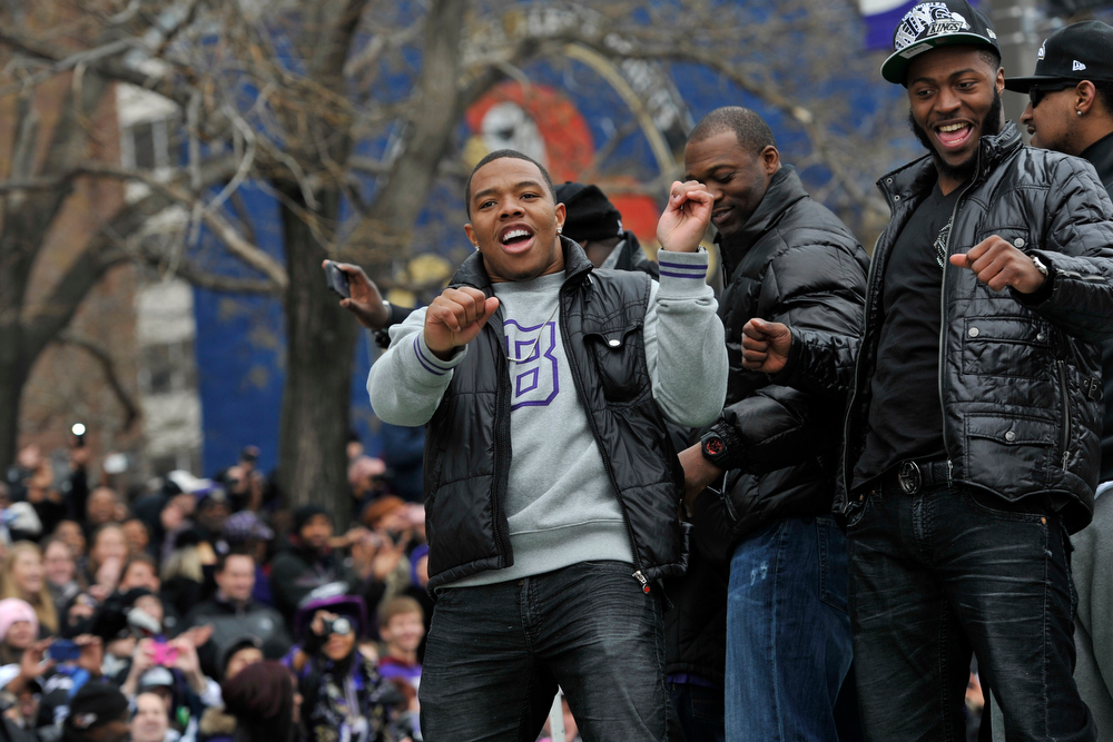 Description of . Baltimore Ravens running back Ray Rice, left, dances on a float with other players during a victory parade Tuesday, Feb. 5, 2013, in Baltimore. The Ravens defeated the San Francisco 49ers in NFL football's Super Bowl XLVII 34-31 on Sunday. (AP Photo/Gail Burton)