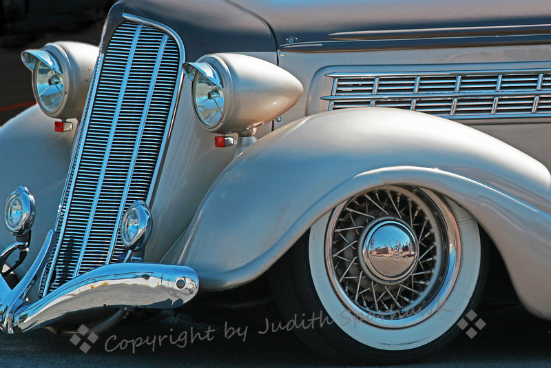 Cruise Beauty ~ At the Route 66 Rendezvous, I enjoyed shooting parts of the many beautifully restored cars.  I don't recall what make this one was, but I liked the swoop of the fenders and the front bumper.