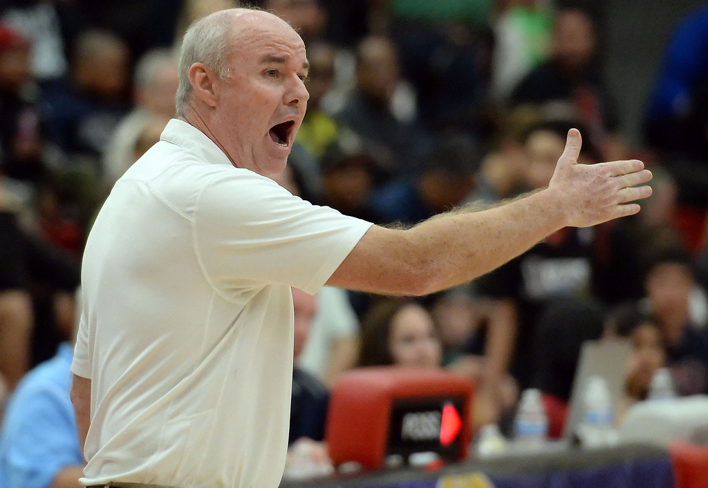 . Bishop Montgomery head coach Doug Mitchell in the first half of a CIF Southern California Regional Division IV basketball game against Cantwell at Colony High School in Ontario, Calif., on Saturday, March 22, 2014.  (Keith Birmingham Pasadena Star-News)