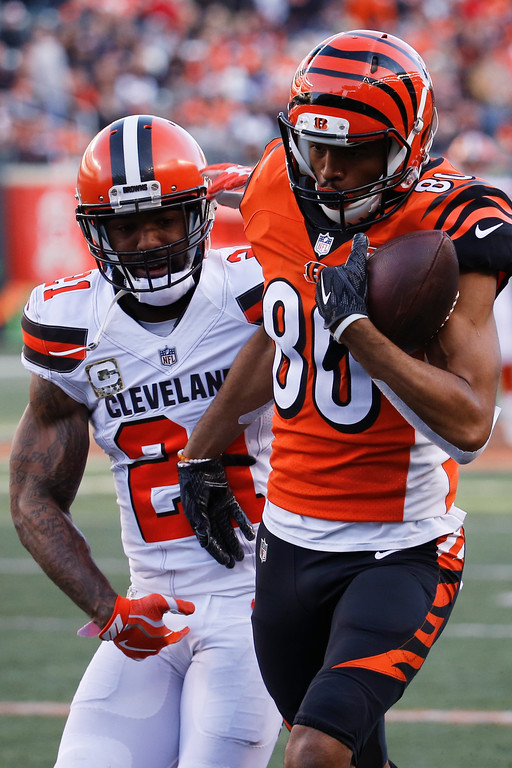 . Cincinnati Bengals wide receiver Josh Malone (80) runs the ball past Cleveland Browns cornerback Jamar Taylor (21) in the second half of an NFL football game, Sunday, Nov. 26, 2017, in Cincinnati. (AP Photo/Frank Victores)