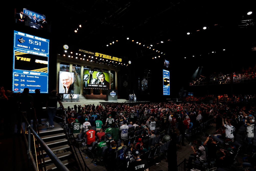 . NFL commissioner Roger Goodell, center, and former Pittsburgh Steelers\' Jerome Bettis, left, and Franco Harris pay tribute to Dan Rooney during the first round of the 2017 NFL football draft, Thursday, April 27, 2017, in Philadelphia.(AP Photo/Julio Cortez)