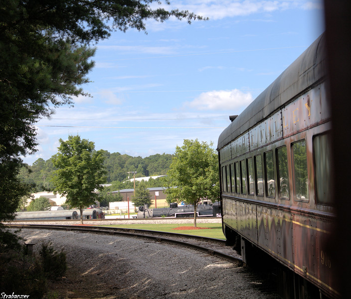 Tennessee Valley Railroad Museum The 10:40 Missionary Ridge Local reverses on the wye at Grand Junction. Chattanooga, TN, 07/13/2019 This work is licensed under a Creative Commons Attribution- NonCommercial 4.0 International License