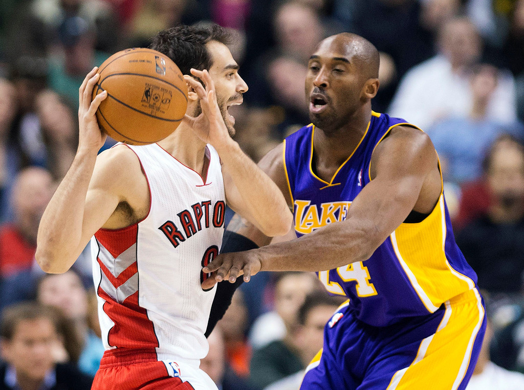 . Toronto Raptors guard Jose Calderon, left, protects the ball from Los Angeles Lakers guard Kobe Bryant, right, during the first half of an NBA basketball game, Sunday, Jan. 20, 2013, in Toronto. The Raptors won 108-103. (AP Photo/The Canadian Press, Nathan Denette)