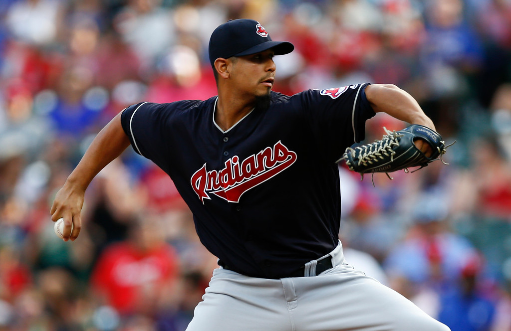 . Cleveland Indians starting pitcher Carlos Carrasco delivers to a Texas Rangers batter during the first inning of a baseball game, Saturday, July 21, 2018, in Arlington, Texas. (AP Photo/Jim Cowsert)