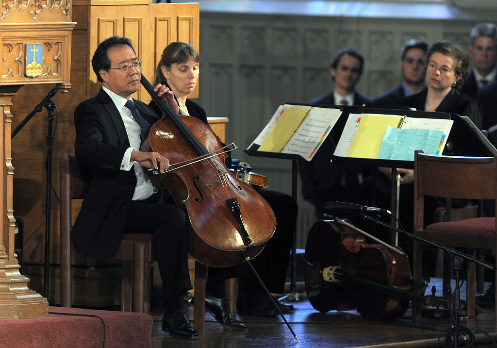 ". Musician Yo-Yo Ma performs during ""Healing Our City: An Interfaith Service\"" dedicated to those who were gravely wounded or killed in the Boston Marathon bombing, at the Cathedral of the Holy Cross in Boston, Massachusetts, on April 18, 2013. AFP PHOTO/Jewel  SAMAD/AFP/Getty Images"