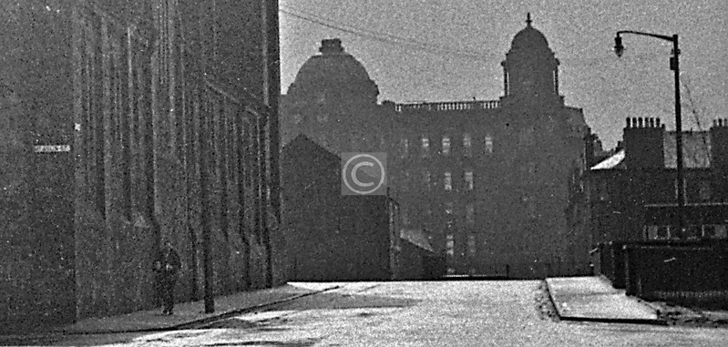 This is a small section of a very poor negative. I offer it as an Impressionist (Pointilliste maybe?)-style view from McAslin St down Glebe St to the Royal.    March 1973