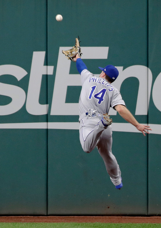 . Kansas City Royals\' Brett Phillips jumps for but can\'t reach a ball hit by Cleveland Indians\' Jose Ramirez during the second inning of a baseball game Tuesday, Sept. 4, 2018, in Cleveland. Ramirez was safe at second base with an RBI double. (AP Photo/Tony Dejak)