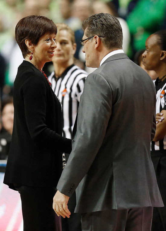 . Notre Dame head coach Muffet McGraw, left, greets Connecticut head coach Geno Auriemma before the first half of the championship game in the Final Four of the NCAA women\'s college basketball tournament, Tuesday, April 8, 2014, in Nashville, Tenn. (AP Photo/John Bazemore)