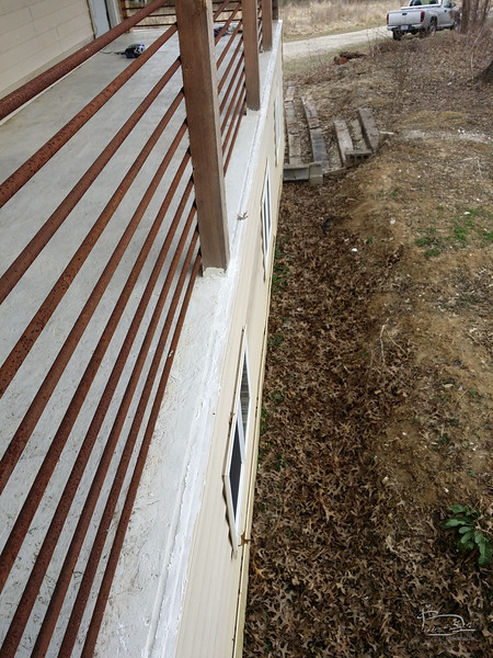 silicone laid down over joint between siding and deck.  Should stop the leaks.
