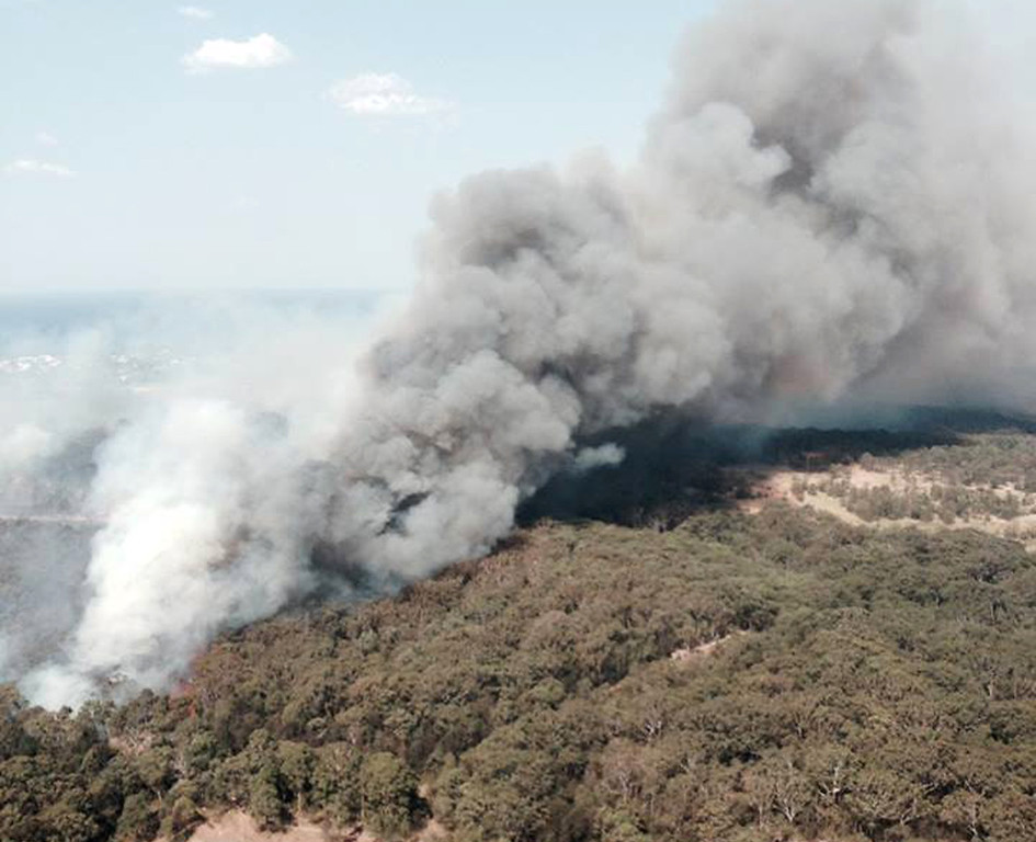 . In this photo provided by the New South Wales Rural Fire Service, smoke rises from a wildfire near Lake Macquarie, New South Wales, Australia, Wednesday, Oct. 23, 2013.  (AP Photo/NSW Rural Fire Service)