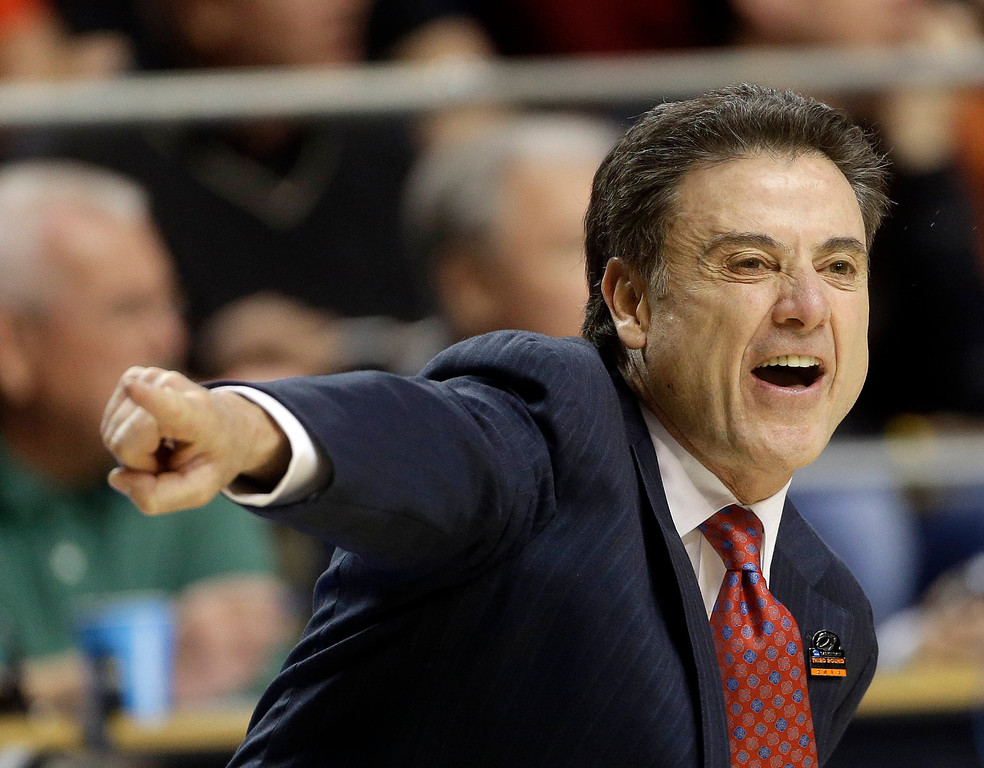 . Louisville head coach Rick Pitino directs his team from the sideline during the first half of a third-round NCAA college basketball tournament game against the Colorado State, Saturday, March 23, 2013, in Lexington, Ky. (AP Photo/John Bazemore)