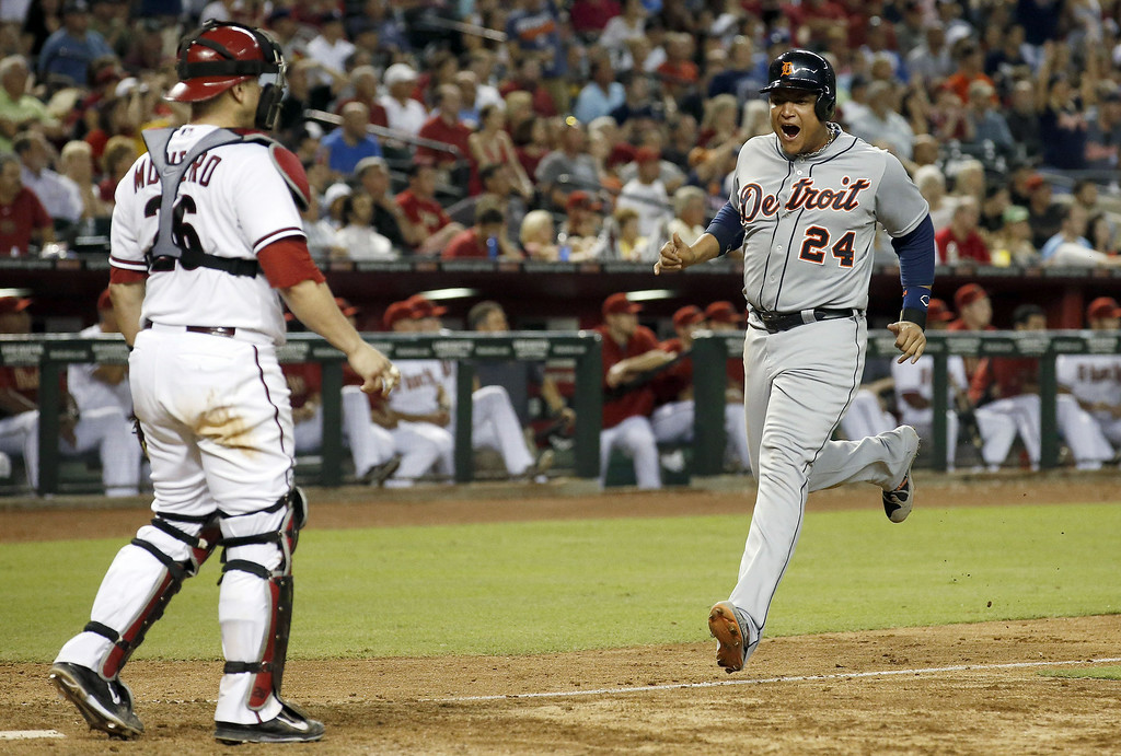 . Detroit Tigers\' Miguel Cabrera (24) shouts in celebration as he comes in to score as Arizona Diamondbacks\' Miguel Montero, left, looks on during the eighth inning of a baseball game on Tuesday, July 22, 2014, in Phoenix. (AP Photo)
