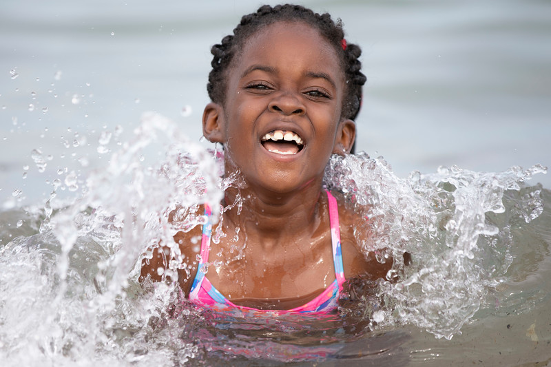 Ny'ailah Taylor Fanroy smiles in Lake Michigan at Bradford Beach on Wednesday, July 17, 2019. Colin Boyle/Milwaukee Journal Sentinel