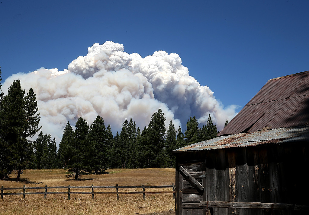 . YOSEMITE NATIONAL PARK, CA - AUGUST 22:  Smoke from the Rim Fire is visible near the Hetch Hetchy reservoir on August 22, 2013 in Yosemite National Park, California. The Rim Fire continues to burn out of control and threatens 2,500 homes outside of Yosemite National Park. Over 1,000 firefighters are battling the blaze that was reduced to only 2 percent containment after it nearly tripled in size overnight.  (Photo by Justin Sullivan/Getty Images)