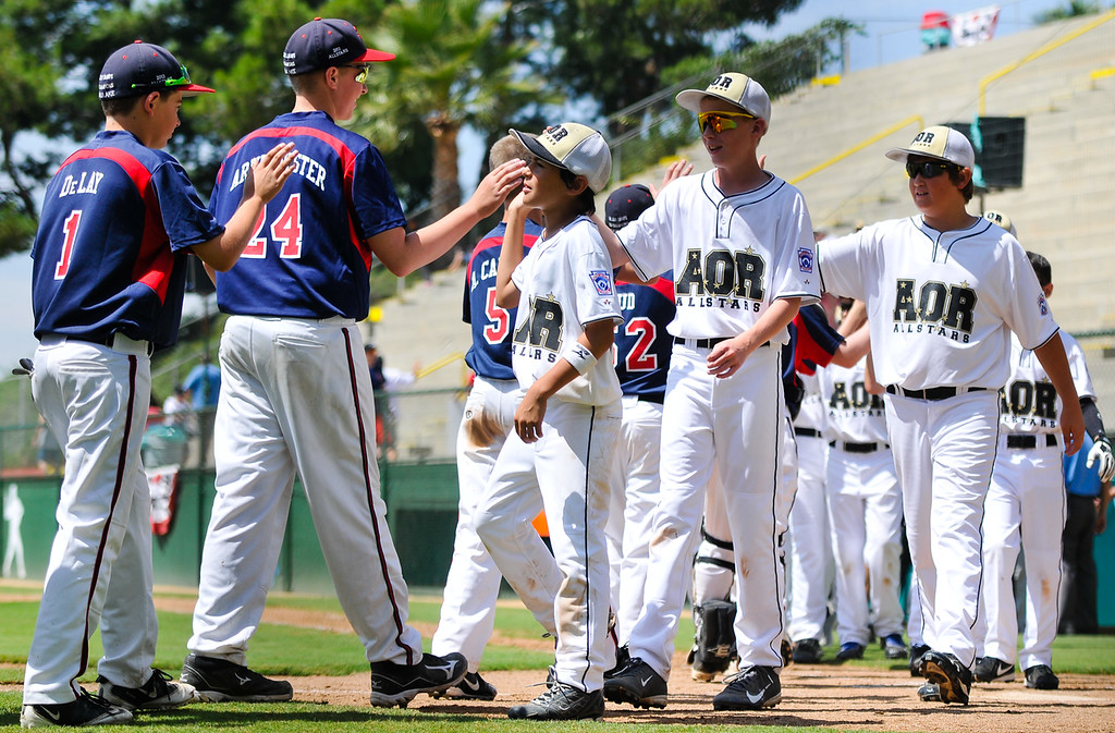 . Alaska little leaguers, right, congratulate Washington, left, on their win after getting defeated by them 2-10 in the Little League Northwest Regional Tournament opening game in San Bernardino on Friday, Aug. 2, 2013. The tournament will run August 2 through 10, which host 12 states representing the West and Northwest Little League regions. (Rachel Luna / Staff Photographer)