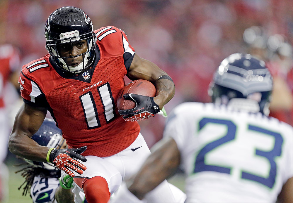 Description of . Atlanta Falcons wide receiver Julio Jones (11) works against Seattle Seahawks cornerback Marcus Trufant (23) during the first half of an NFC divisional playoff NFL football game Sunday, Jan. 13, 2013, in Atlanta. (AP Photo/David Goldman)