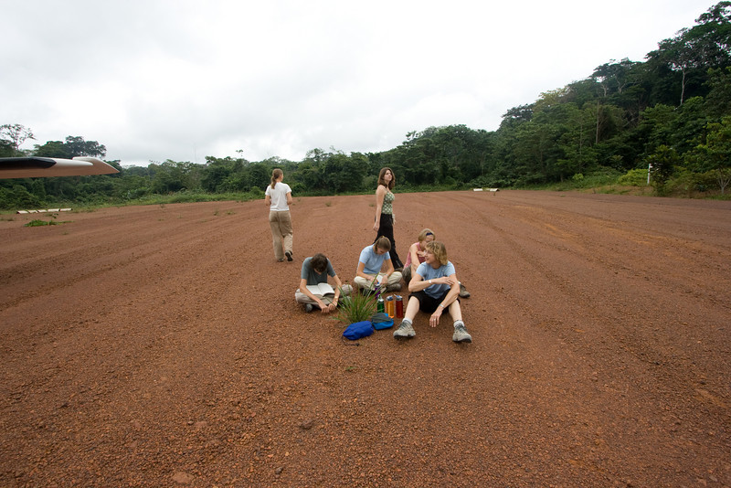 Waiting on the runway for the Land Cruiser that will take us to the Langoue Bai trailhead.
