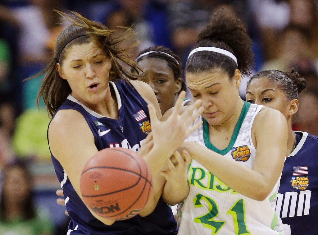 . Connecticut center Stefanie Dolson (31) and Notre Dame guard Kayla McBride (21) battle for a rebound in the first half of the women\'s NCAA Final Four college basketball tournament semifinal, Sunday, April 7, 2013, in New Orleans. (AP Photo/Gerald Herbert)
