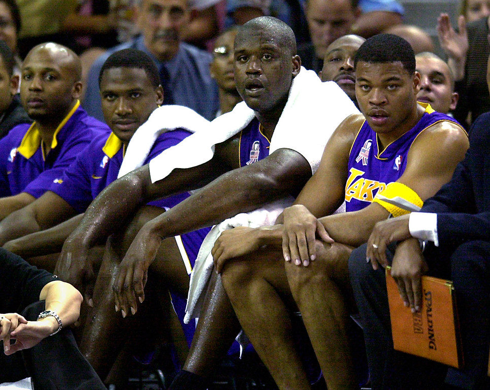 . Los Angeles Lakers\' Shaquille O\'Neal, center, watches the action against the Sacramento Kings from the bench after fouling out in the fourth quarter of Game 5 of the Western Conference finals in Sacramento, Calif., Tuesday, May 28, 2002. Joining O\'Neal are teammates Brian Shaw, left, Lindsey Hunter, second from left, and Devean George. The Kings went on to win 92-91 to take a 3-2 edge in the best-of-seven series. (AP Photo/Paul Sakuma)