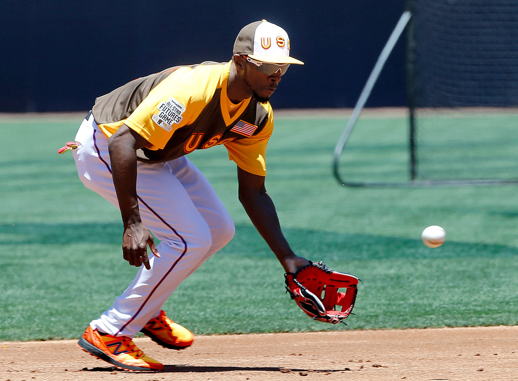 . U.S Team\'s Travis Demeritte, of theTexas Rangers, warms up prior to the All-Star Futures baseball game against the World team, Sunday, July 10, 2016, in San Diego. (AP Photo/Lenny Ignelzi)