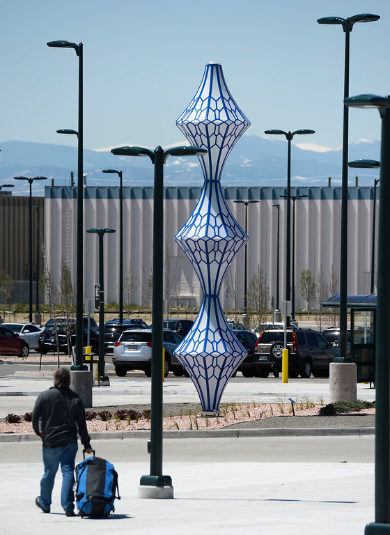 . DENVER, CO - May 03: An illuminated  sculpture from artist Blessing Hancock entitled �Biota� at the RTD\'s University of Colorado A Line Peoria station May 03, 2016. The public art piece, which is part of the RTD\'s ART-N-TRANSIT program. (Photo by Andy Cross/The Denver Post)