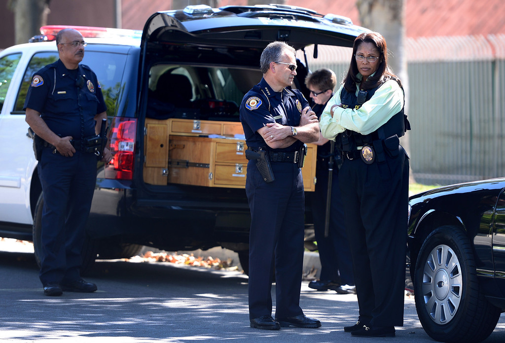 . Pasadena Police Chief Phillip Sanchez and Detective Sgt. Tory Riley standby as Pasadena Police investigate an officer involved shooting at Kings Village in Pasadena Friday, October 11, 2013. (Photo by Sarah Reingewirtz/Pasadena-Star News)