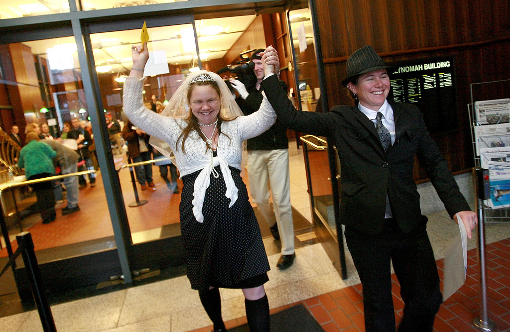. PORTLAND, OR - FEBRUARY 4:  Jessica Blaylock, 9 months pregnant and due in two days, and her partner of nine-years Megan Greenauer, cheer after registering as domestic partners at the Multnomah County building February 4, 2008 in Portland, Oregon. Domestic partnership law that allows gay couples many of the same benefits as married couples, belatedly took effect after a federal judge\'s ruling on disqualifying petition signatures, including joint tax returns and the ability to make medical decisions on each other\'s behalf among others. (Photo by Craig Mitchelldyer/Getty Images)
