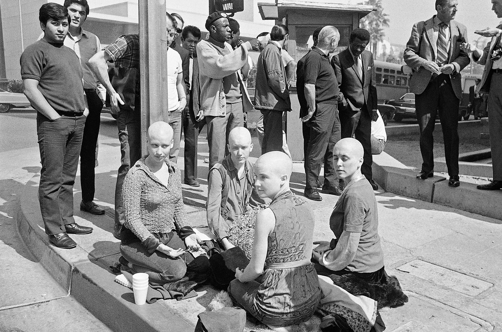 ". Four young women members of the Charles Manson ""family\"" kneel on the sidewalk outside the Los Angeles at Hall of Justice, March 29, 1971 with their heads shaved. They\'ve kept a vigil at the building throughout the long trial in which Manson and three other women were convicted of slaying actress Sharon Tate and six others.  Left to right: Cathy Gillies, Kitty Lutesinger, Sandy Good, Brenda McCann. Jurors were believed near a verdict on the penalty to be imposed on the defendants. (AP Photo/Wally Fong)"
