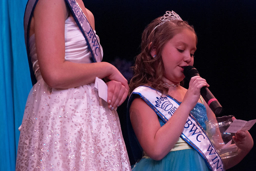. Kayla Rice/Reformer 2013 Winter Carnival Princess Kyla Brown reads a question during the 2014 Brattleboro Winter Carnival Queen\'s Pageant on Friday evening.