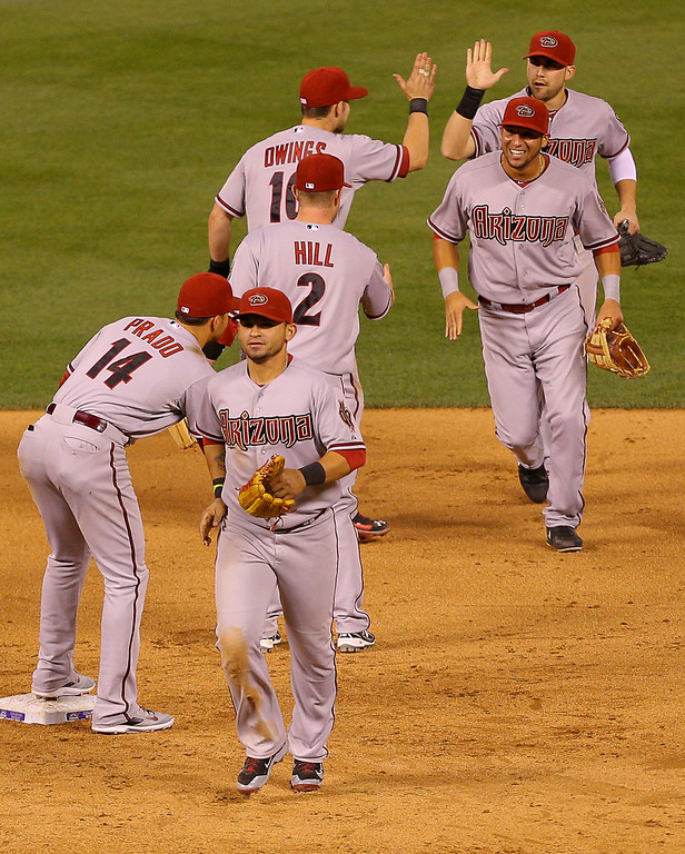 . The Arizona Diamondbacks celebrate a 12-7 win against the Colorado Rockies at Coors Field on June 5, 2014 in Denver, Colorado.  (Photo by Justin Edmonds/Getty Images)