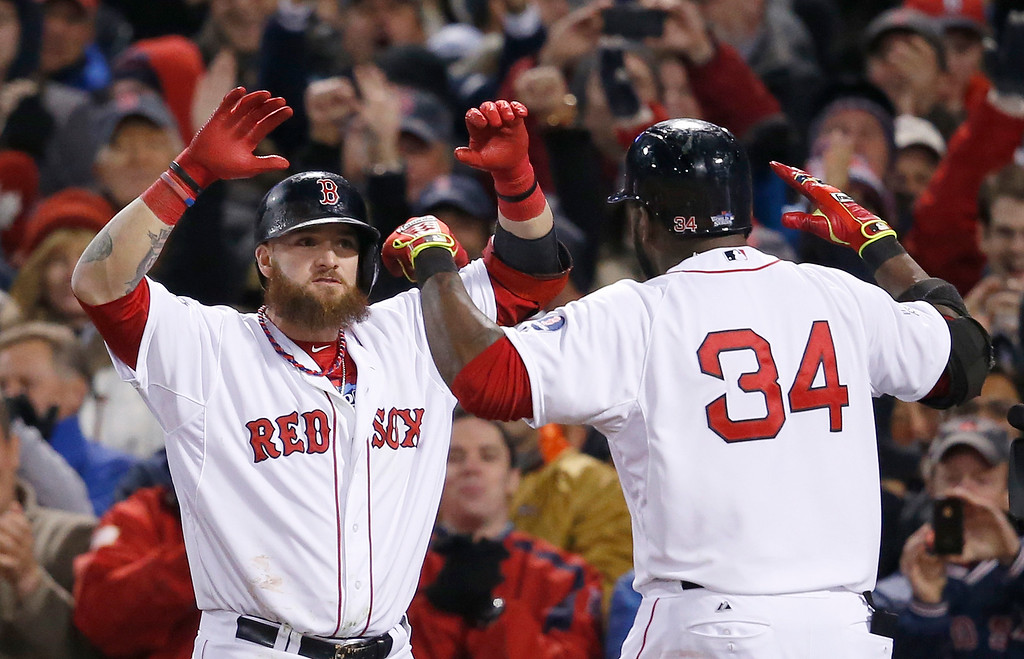 . Boston Red Sox\'s David Ortiz celebrates with Jonny Gomes, left, after Ortiz hit a two-run home run off St. Louis Cardinals starting pitcher Michael Wacha during the sixth inning of Game 2 of baseball\'s World Series Thursday, Oct. 24, 2013, in Boston. (AP Photo/Elise Amendola)