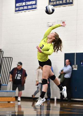 10/23/2019 Mike Orazzi | StaffrBristol Eastern's Rebecca Bender (3) against RHAM during girls volleyball at Bristol Eastern on Wednesday night. r