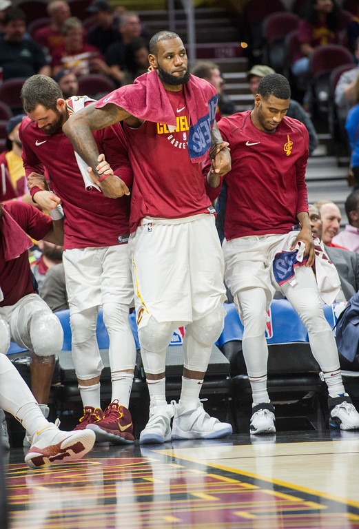. Cleveland Cavaliers\' LeBron James, center, Kevin Love, left, and Iman Shumpert stand during a time out against the Chicago Bulls during the second half of an NBA preseason basketball game in Cleveland, Tuesday, Oct. 10, 2017. The Bulls won 108-94. (AP Photo/Phil Long)