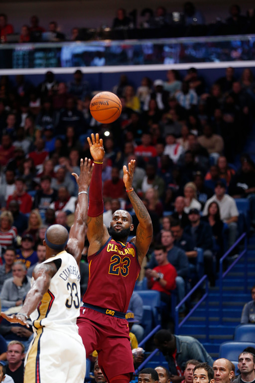 . Cleveland Cavaliers forward LeBron James (23) shoots over New Orleans Pelicans forward Dante Cunningham (33) in the first half of an NBA basketball game in New Orleans, Saturday, Oct. 28, 2017. (AP Photo/Gerald Herbert)