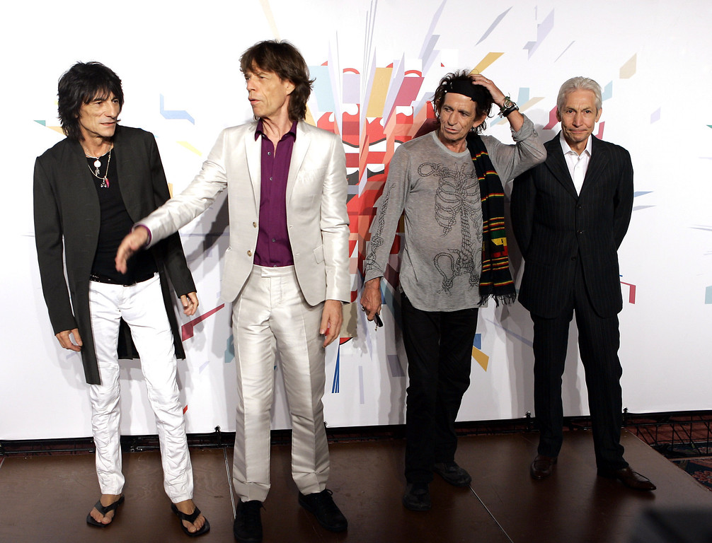 ". Rolling Stones members, from left, Ron Wood, Mick Jagger, Keith Richards and Charlie Watts pose for photos at a press conference in Milan, Italy, Monday, July 10, 2006. The Rolling Stones are to play a concert in Milan Tuesday as part of their ""A Bigger Bang\"" world tour. The performance is their first in mainland Europe. (AP Photo/Antonio Calanni)"