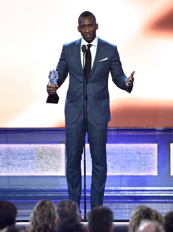 """. Mahershala Ali accepts the award for best supporting actor for \""""Moonlight\"""" at the 22nd annual Critics\' Choice Awards at the Barker Hangar on Sunday, Dec. 11, 2016, in Santa Monica, Calif. (Photo by Chris Pizzello/Invision/AP)"""