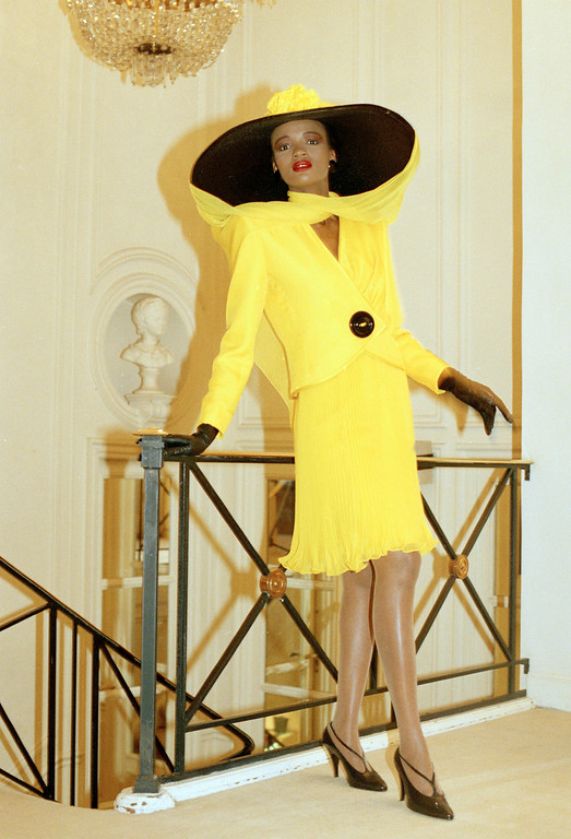 . Rebecca presents a two-piece suit in yellow chiffon worn with a large felt hat topped by a silk veil designed by Danish designer Erik Mortensen for French fashion house Pierre Balmain as a preview for the spring-summer haute couture collection in Paris, Jan.19, 1989.  (AP Photo/Laurent Rebours)