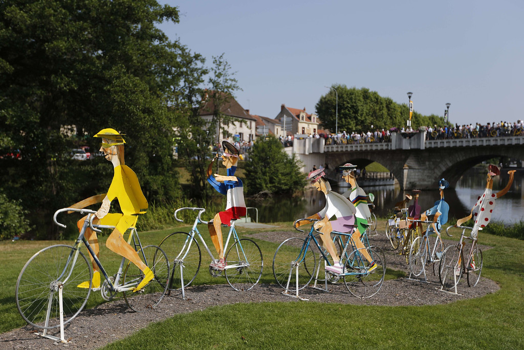 . Life-sized silhouettes of cyclists are displayed in Saint-Pourçain-sur-Sioule near the village departure before the start of the 191 km fourteenth stage of the 100th edition of the Tour de France cycling race on July 13, 2013 between Saint-Pourcain-sur-Sioule and Lyon, central eastern France. JOEL SAGET/AFP/Getty Images
